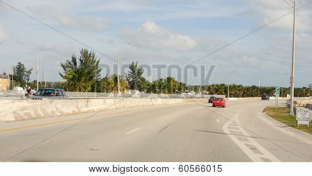 MIAMI, FLORIDA - DEC 24, 2009: Cars on road on December 24, 2009 in Miami, Florida. Miami is a city located on the Atlantic coast in southeastern Florida and the county seat of Miami-Dade County