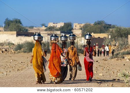 Women Carrying Water In Rajasthan
