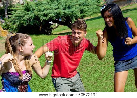 Young Man Holding Two Girls Fighting For Him