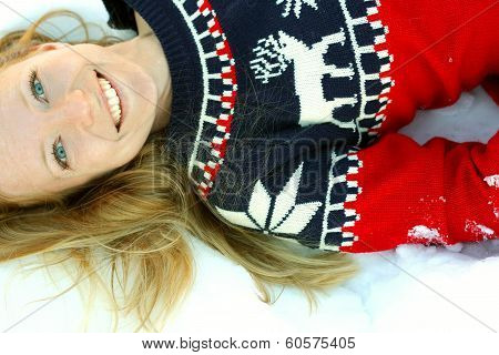 Woman Laying In Winter Snow