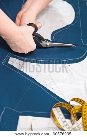 Fitter Cuts Out Dress According With Pattern