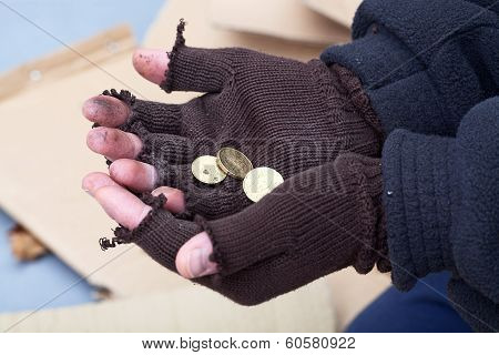 Mans Stretching Out Hands For A Money