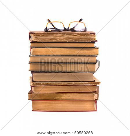 Pile of old books (glasses from above) isolated on white background.
