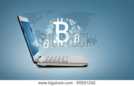 technology and advertisement concept - laptop computer with bitcoin