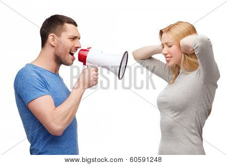 couple, family and relationship problems concept - boyfriend screaming though megaphone at his girlfriend