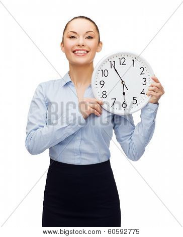 business and time concept - attractive businesswoman with wall clock