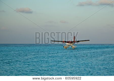 Landing seaplane in the lagoon