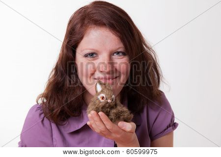 young women with bunny, plush toy