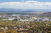 stock photo of cbd  - A view over Canberra CBD from Mt Ainslie on a sunny autumn day - JPG