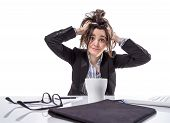 picture of pulling hair  - Portrait of stressed and frustrated young business woman pulling her hair over white background - JPG