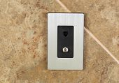 picture of hookup  - Horizontal photo of a phone jack and cable outlet on tiled wall - JPG