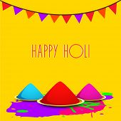 pic of holi  - Indian festival Happy Holi celebrations concept with colors on yellow background - JPG