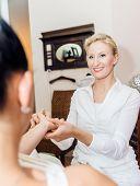 picture of reflexology  - reflexology hand massage by a blonde therapist - JPG
