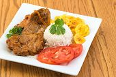 stock photo of lamb shanks  - Angles of the traditional stewed lamb made and served the Cuban way - JPG