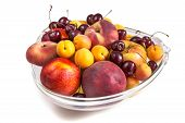 stock photo of fruit platter  - Platter of a assorted fresh fruit cut professionally - JPG