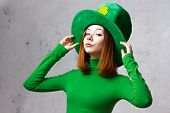 stock photo of freckle face  - Red hair girl in Saint Patrick - JPG