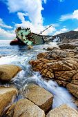 shipwreck close bay in hong kong sunshine blue sky white cloud