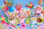 pic of chocolate spoon  - colorful birthday party table with homemade sweets for kids ( top view)
