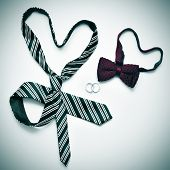 image of gay wedding  - a tie and a bow tie forming hearts and wedding rings - JPG