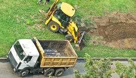 stock photo of dumper  - tractor and dumper on city grass - JPG