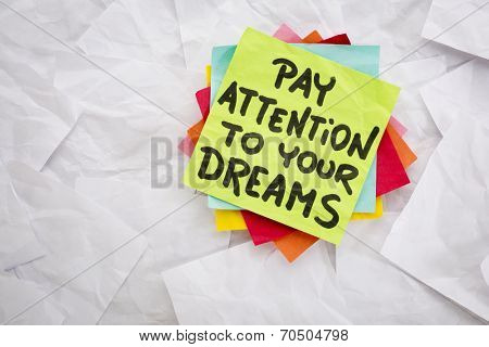 pay attention to your dreams  - reminder or advice handwritten on a colorful sticky note