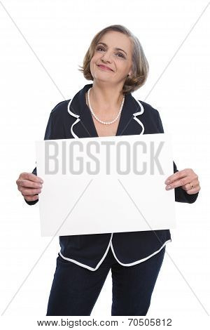 Portrait: Isolated Senior Businesswoman Holding A White Sign For Promotion.
