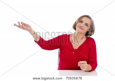 Isolated Senior Business Woman In Red Presenting With Hand.