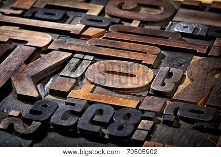 random collection of antique letterpress printing blocks