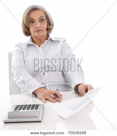 Shocked Senior Businesswoman Looking At Increasing Costs.