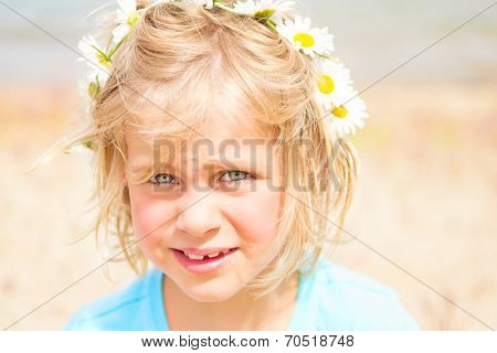 Pretty Little Blond Girl With A Crown Of Daisies
