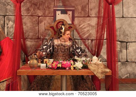 MUSKOGEE, OK - MAY 24: Queen greets her guests at the Queen's Tea party at the Oklahoma 19th annual Renaissance Festival on May 24, 2014 at the Castle of Muskogee in Muskogee, OK