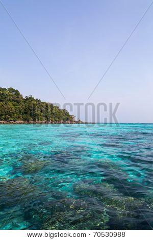 Cristal Blue Sea Under A Blue Sky