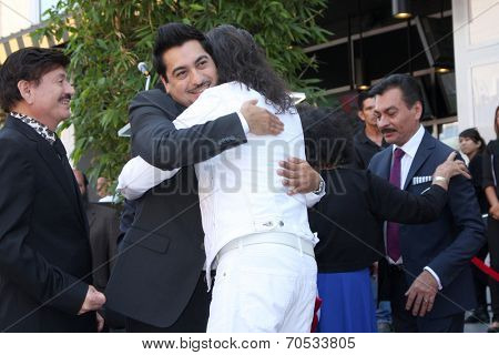 LOS ANGELES - AUG 21:  Los Tigres Del Norte, Marco Antonio Solis at the Los Tigres Del Norte Honored On The Hollywood Walk Of Fame at Live Nation Building on August 21, 2014 in Los Angeles, CA