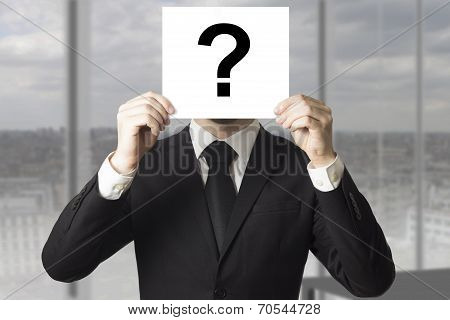 Businessman Hiding Face Behind Sign Question Mark