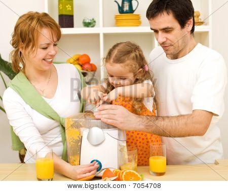 Family Making Fresh Fruit Juice Together