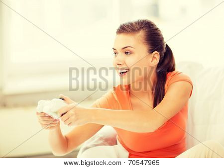 picture of happy woman with joystick playing video games