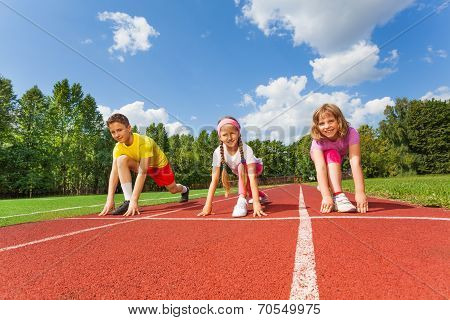 Smiling children in ready position to run