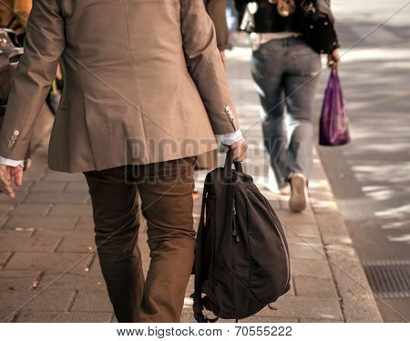 Man In Beige Clothes On Sidewalk