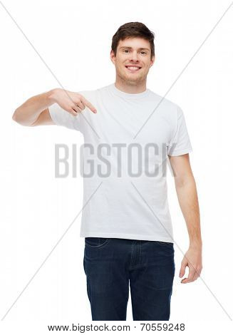 t-shirt design, gesture and people concept - smiling young man in blank white t-shirt pointing finger on himself