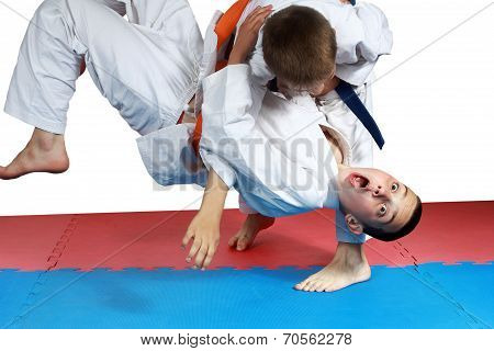 Sportsman with a blue belt doing judo throw