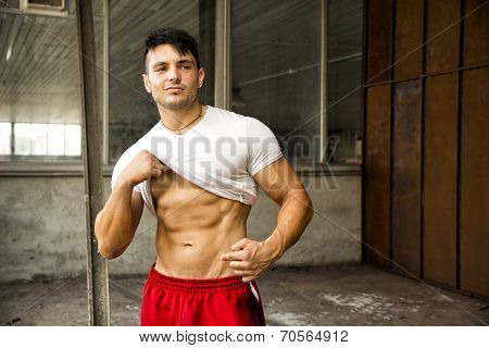 Muscular Young Man Portrait Indoors