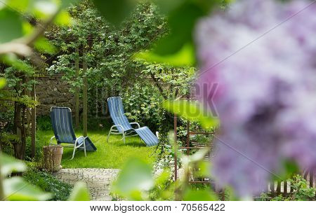Time Out In The Garden - Lounger Chairs On The Terrace.