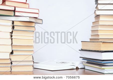 Close-up Of Working Place With Books