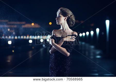 Woman posing in the rain.