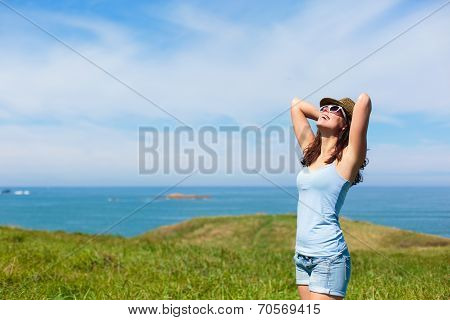 Happy Woman Enjoying Coast Vacation Travel
