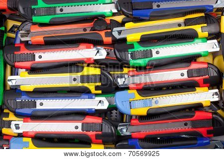 Multi colored utility knifes.
