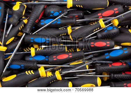Pile of multicolored screwdrivers.