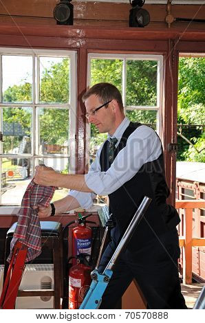 Signalman in signal box, Highley.