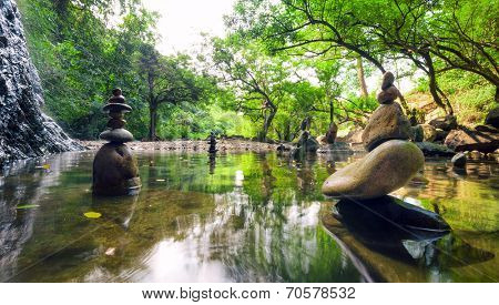 Zen garden. Meditate spiritual landscape of green forest with calm pond water and stone balance rocks