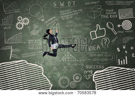 Business Woman Leaping Over A Gap